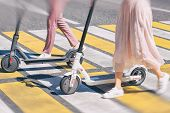 Woman Legs And Man Legs Walking With Scooter On Cross Road poster
