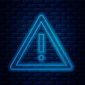 Glowing Neon Line Exclamation Mark In Triangle Icon Isolated On Brick Wall Background. Hazard Warnin poster