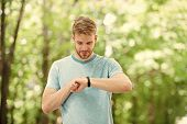 Smart Fitness. Fit Athlete Tracking His Fitness Activity With Sports Watch. Handsome Athlete Using F poster