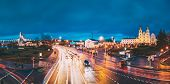 Minsk, Belarus. Panorama With Night Traffic On Illuminated Street And Cathedral Of Holy Spirit In Mi poster
