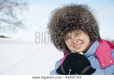 Woman Tourist Skier In Snowy Forest