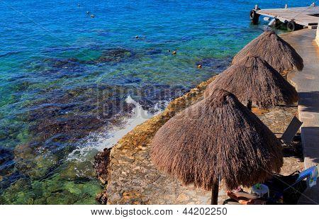 Palapas on the Caribbean Beach