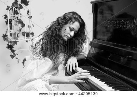 Monochrome Shot Of Romantic Girl Playing Piano