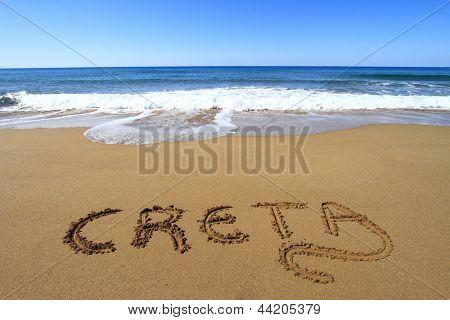 Creta written on sandy beach