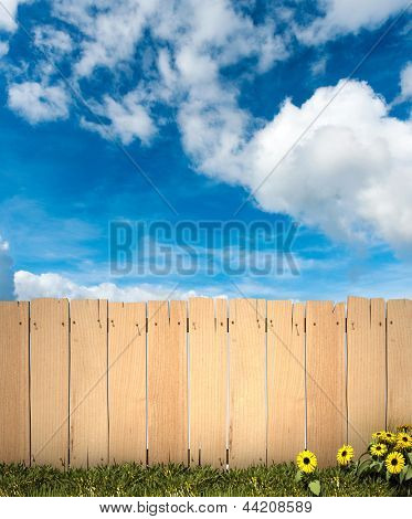3D rendering of a wooden fence with blue sky in the background, ideal for inserting a message or image