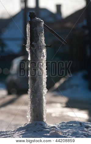 frozen water-tap on ice rock