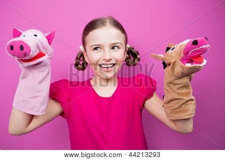 Happy child, creative fun concept - girl playing in the theater