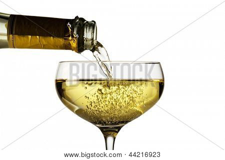 champagne bottle with glass of champagne. symbolic photo for celebrations and new year.