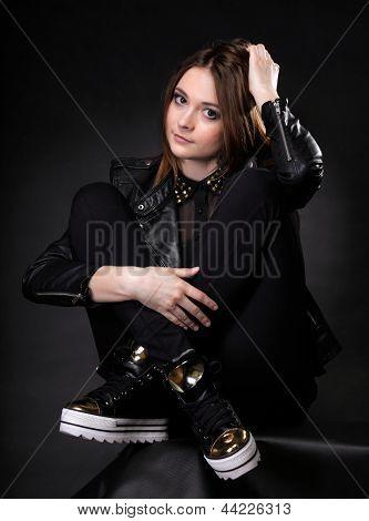 Beautiful Woman Portrait In Rock Style