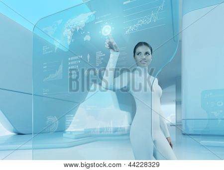 Future technology touchscreen interface. Girl touching screen interface in hi-tech interior. Business lady pressing virtual button in futuristic office.
