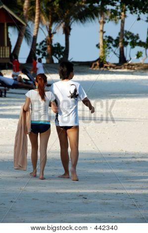 Copule Strolling On Beach