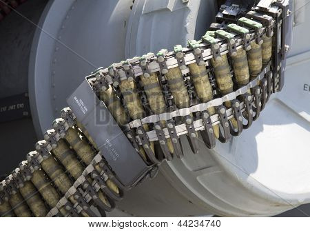 Round of ammunition loaded into .50-caliber machine gun on US Navy destroyer during Fleet Week 2012