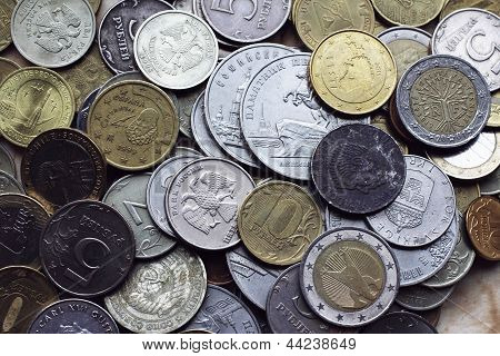 Coins From Different Countries Currency, The Euro, The Dollar, The Krona, Mark, Rur