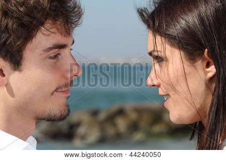 Close Up Of A Couple Looking Each Other With Love