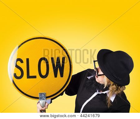 Man Holding Slow Sign During Adverse Conditions