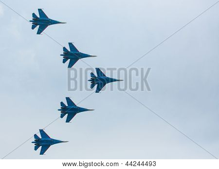 LANGKAWI, MALAYSIA - MAR 26: Russian Air Force Aerobatic Team Russian Knights performing during on LIMA13 Langkawi International Maritime & Aerospace Exhibition on Mar 26, 2013 in Langkawi, Malaysia.