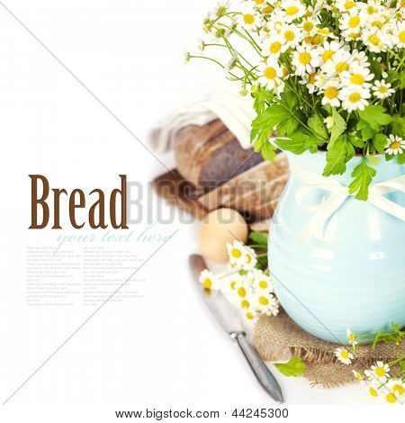 fresh chamomile flowers and bread over white (with easy removable text)