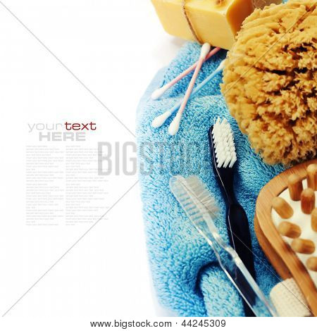 Spa and Wellness- anti-cellulitis spa massage brush, sponge, towel  and soap over white (with easy removable sample text)