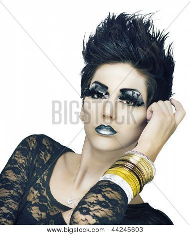 Dramatic fantasy futuristic makeup styling on female beauty model with short spiky hair