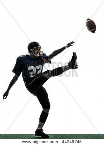 one caucasian american football player man kicker kicking in silhouette studio isolated on white background