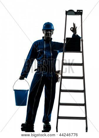 one caucasian repairman worker silhouette in studio on white background
