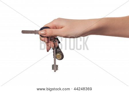 Female Hand Holding A Key To The House