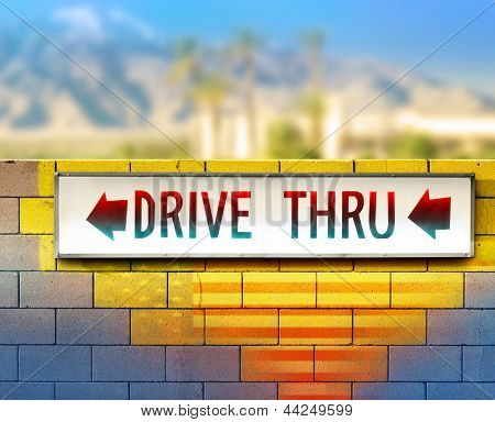 Colorful image of an old drive thru sign on wall