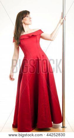 woman in a dress near the pole