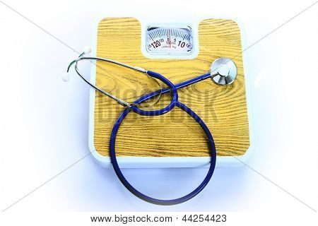 stethoscope and balance symbol photo for weight control