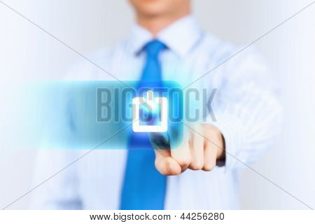 Young man  press the power button