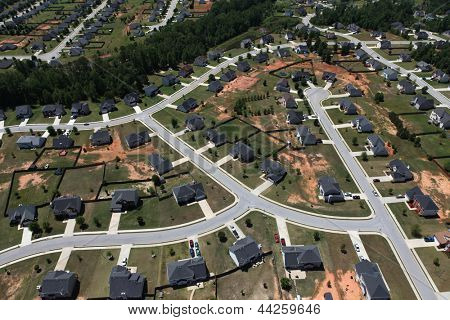 Modern middle class suburban neighborhood aerial.