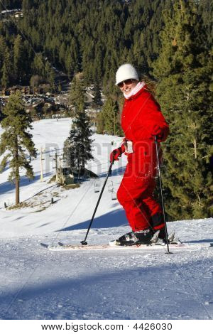 Active Girl On Ski In Mountains