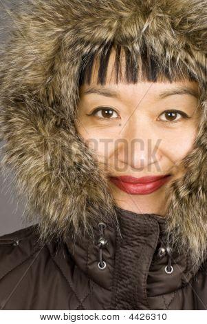 Asian Woman Wearing A Fur Hood