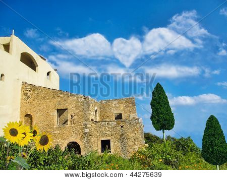 Old House And Heart Shaped Clouds On Blue Sky Background