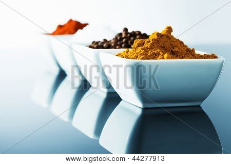 spices in small bowls in row