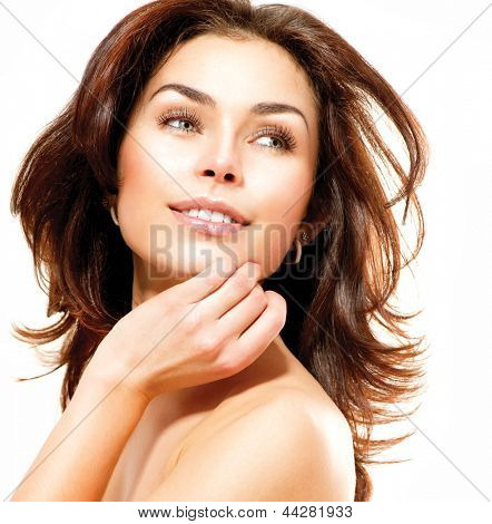 Beauty Woman. Beautiful Young Female touching Her Skin. Portrait isolated on White Background. Healthcare. Perfect Skin. Beauty Face