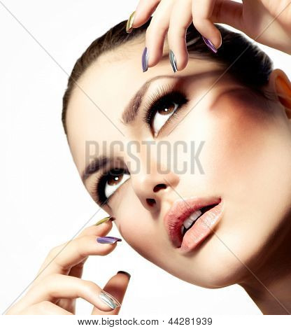 Fashion Beauty Model. Vogue Style Glamour Woman. Manicure and Make-up. Nail Art. Beautiful Girl With Colorful Nails and Luxury Makeup. Beautiful Girl Face and Hand