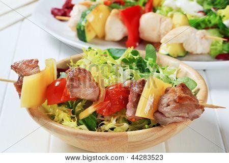 Dietetic salad and freshly grilled skewer