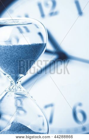 Concept of time - Hourglass and clock