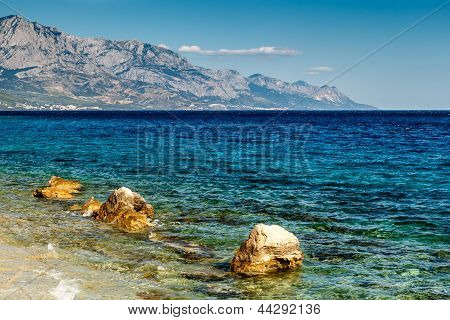 Beautiful Adriatic Beach Near Split And Biokovo Mountains In Background, Croatia