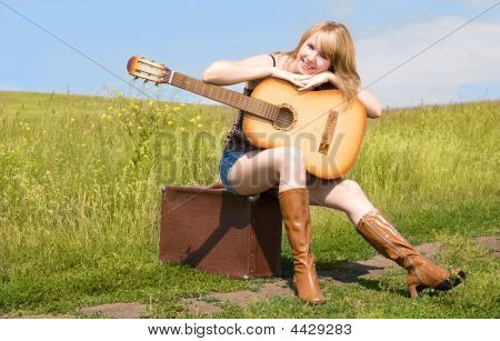 Beutiful Woman With A Guitar Outdoor