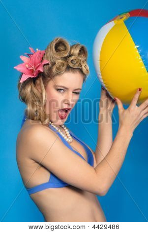 Cute Fifties Style Pin-Up Girl With Ball