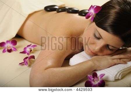 Spa Massge Hot Mineral Stones And Flowers
