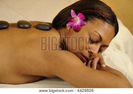 Spa Massage Hot Mineral Stone With Flower In Hair