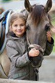 stock photo of pasture  - Horse and lovely girl equestrian - JPG