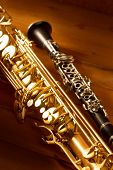 stock photo of sax  - Classic music Sax tenor saxophone and clarinet in vintage wood background - JPG