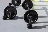stock photo of kettlebell  - Kettlebells at crossfit gym with lifting bar weights fitness equipment - JPG