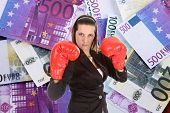 foto of troika  - Portrait of a young female entrepreneur wearing boxing gloves - JPG