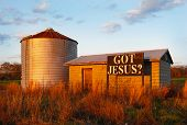 picture of silo  - Sign near a farm silo and meadow reading - JPG