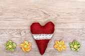 stock photo of bordure  - Red heart and blossoms of cloth on a weathered wooden board - JPG